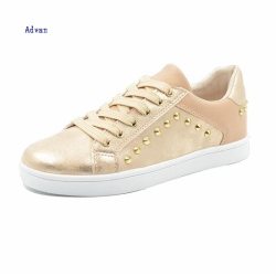 Fashion women sneakers with rivets in golden color